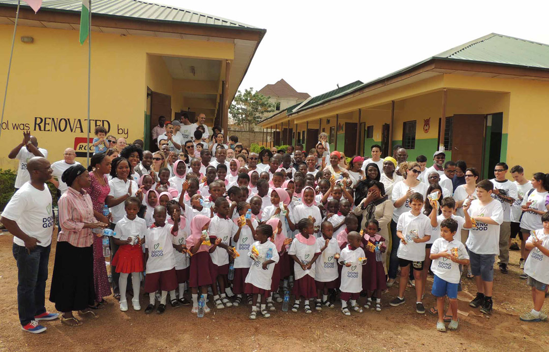 Volunteers renovate a school