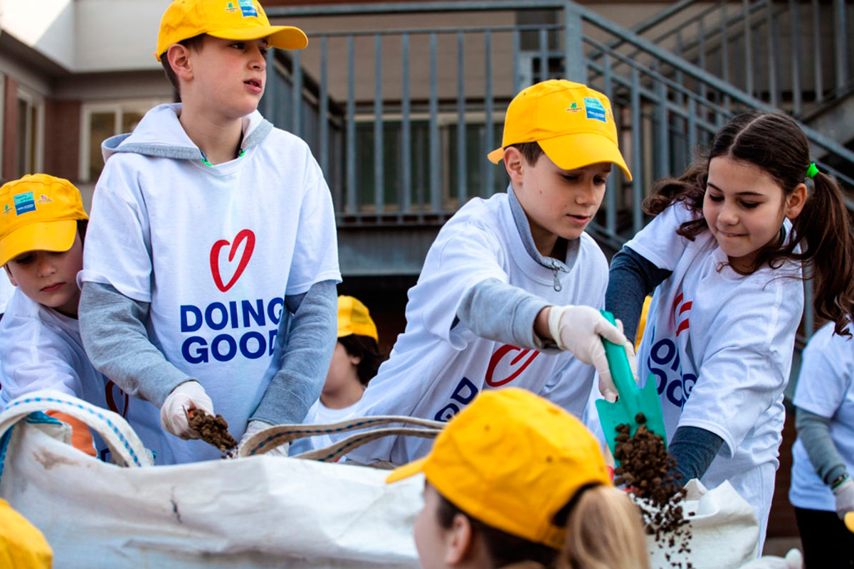 Children beautify a local park in Rome, Italy (Good Deeds Day)