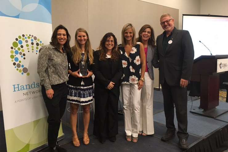 The Good Deeds Day team at the award ceremony with Points of Light's CEO, Tracy Hoover (2nd on right), and HandsOn Network's Executive Director, Alison Doerfler.