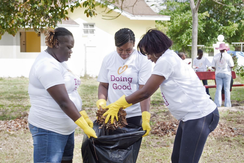 Miya Bahamas cleans up a playground.