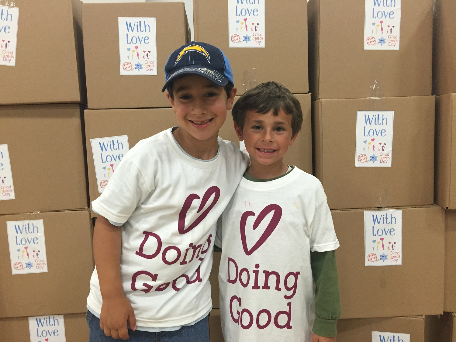 Smiling kids from Ken Jewish Community send boxes of love.
