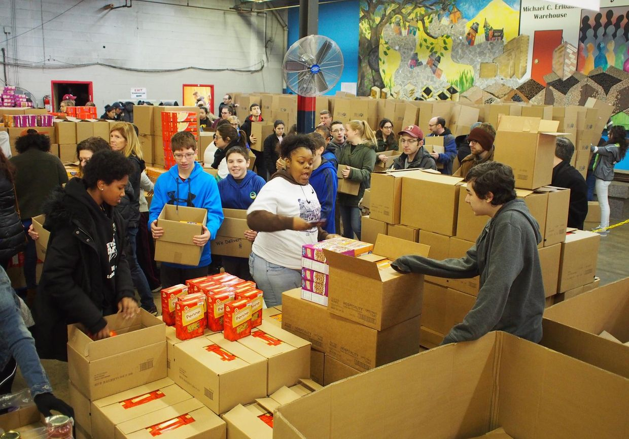 Volunteers for the Jewish Relief Agency package goods to be distributed to those in need.
