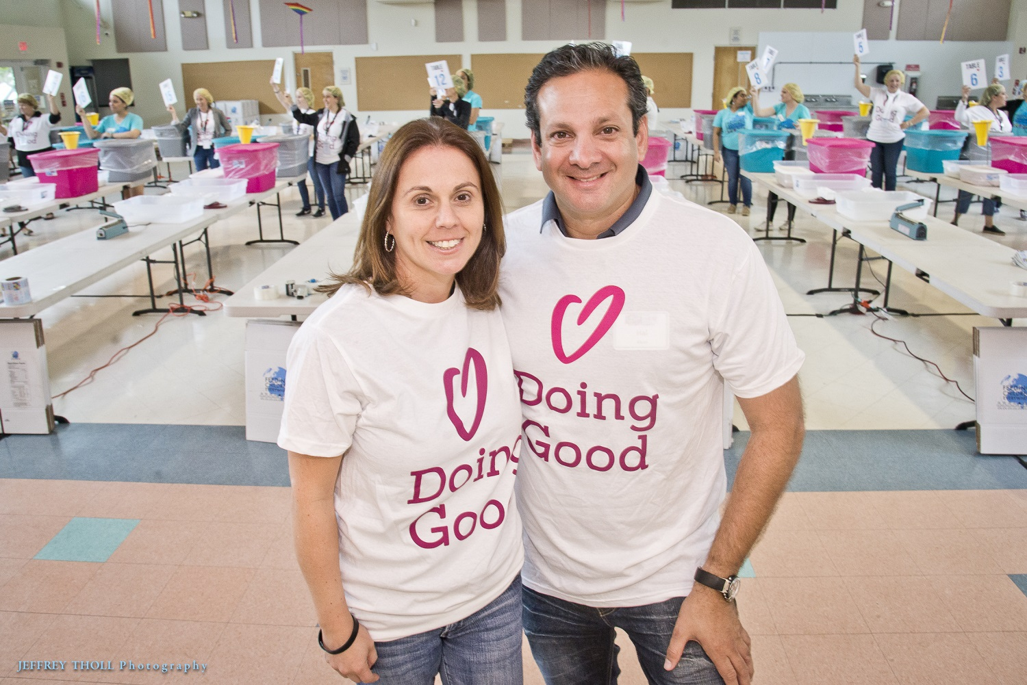 Volunteers from the Jewish Federation of south Palm Beach County smile wide while doing good.