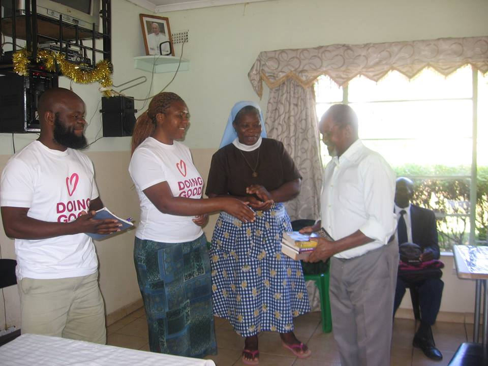 Volunteers from Rebuild Sakubva celebrating their love of books on Good Deeds Day 2017
